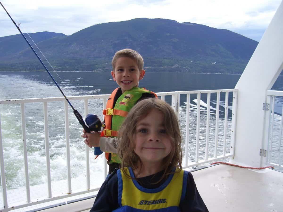 Noah fishing on the houseboat