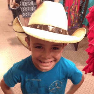 Trying on hats at the Stockyards