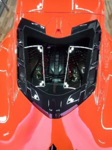 The 2020 Corvette LT2 V8 engine is visible through a rear hatch window.